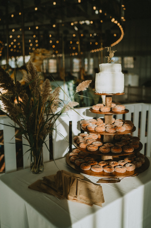 Donut stand and dried pampas grass at hudson valley wedding