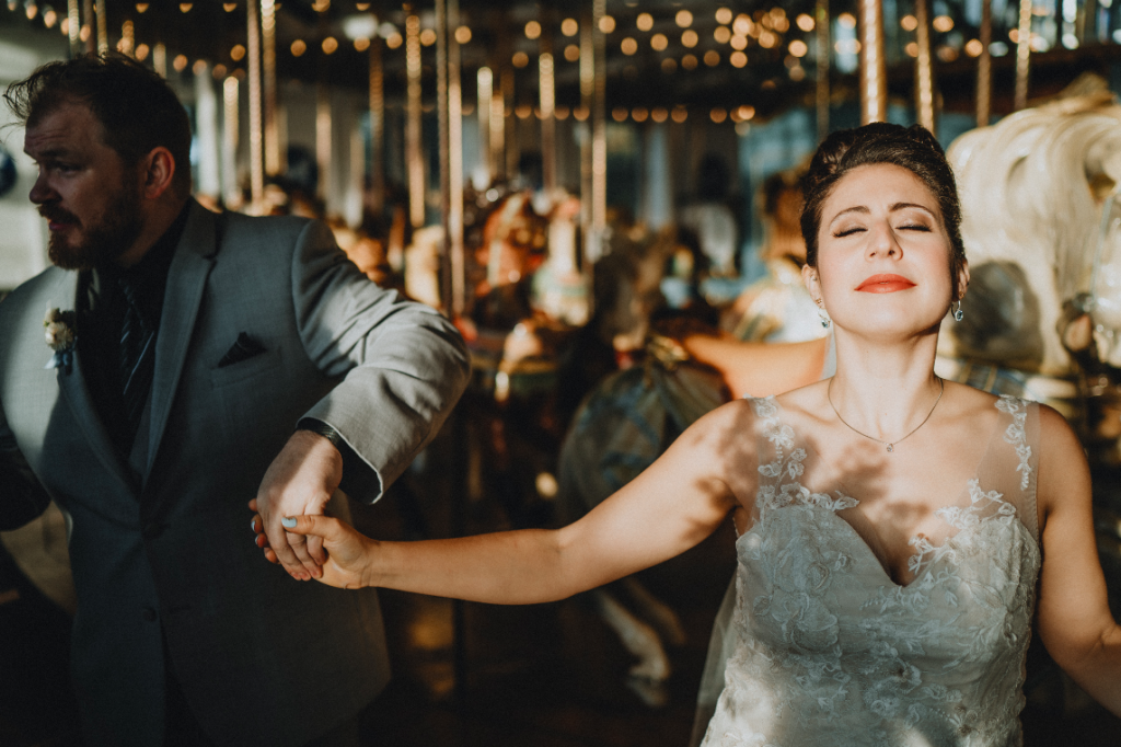 Groom and bride dance on carousel at hudson valley wedding