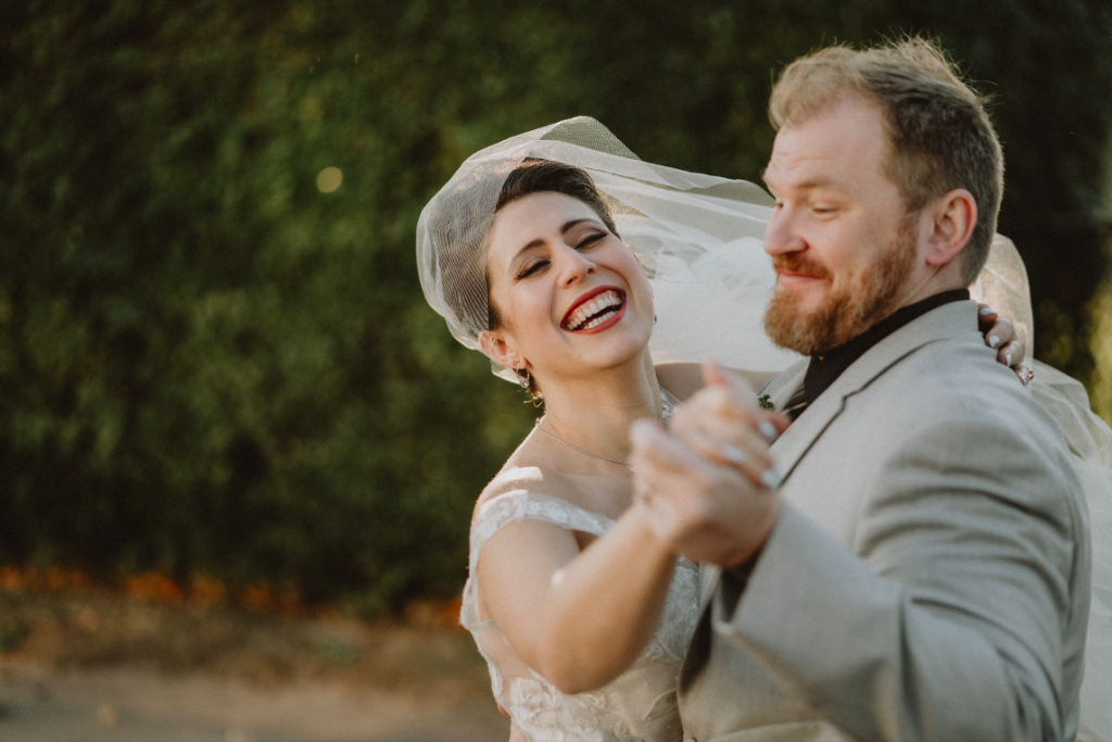 Candid portrait of bride and groom dancing at hudson valley wedding