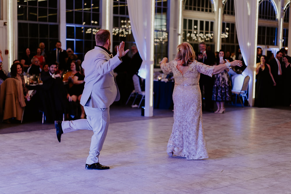 Groom and his mom being goofy on dance floor at hudson valley wedding