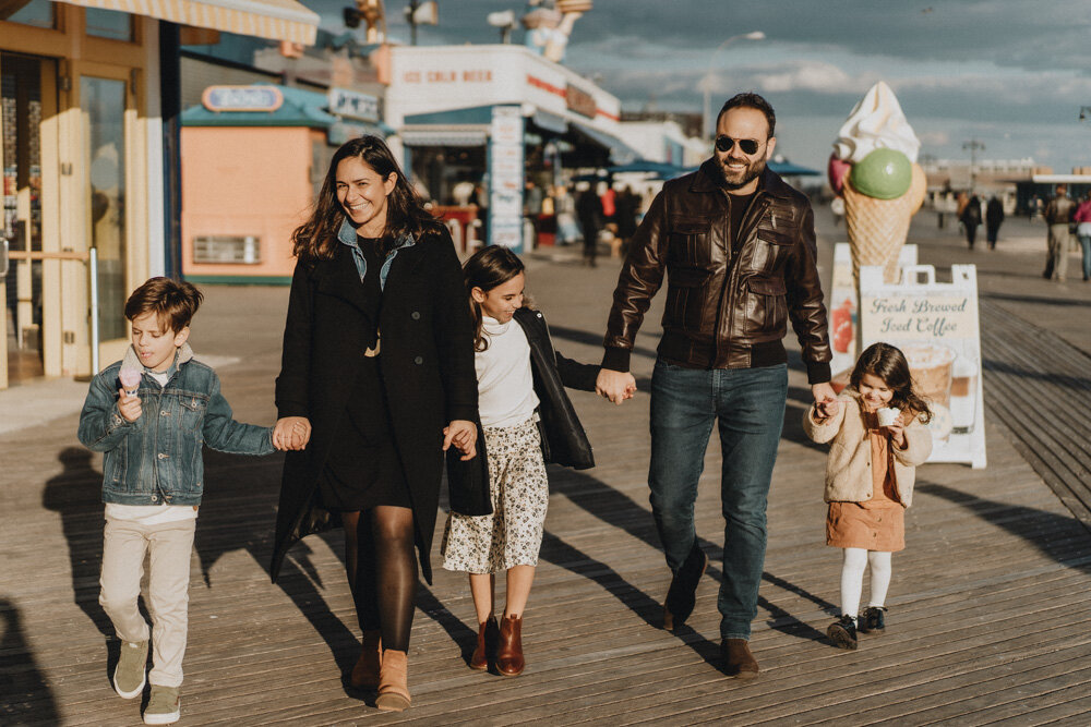 Parents and three kids during family session at coney island boardwalk
