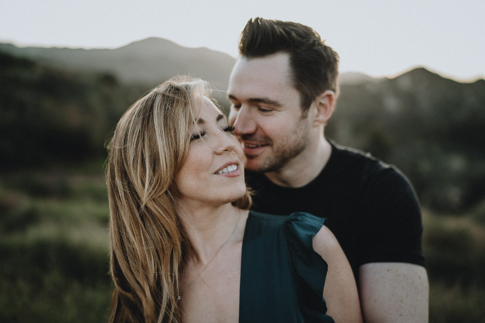 Man snuggles fiancée during engagement session in los angeles canyon