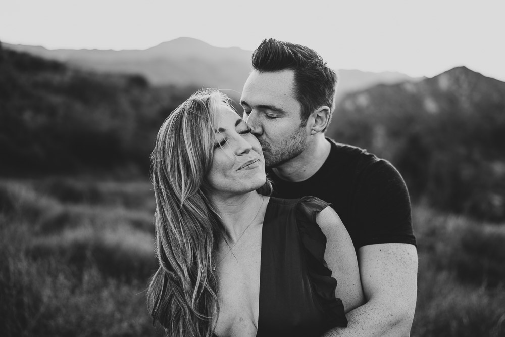 Man kisses fiancée during engagement session in los angeles canyon