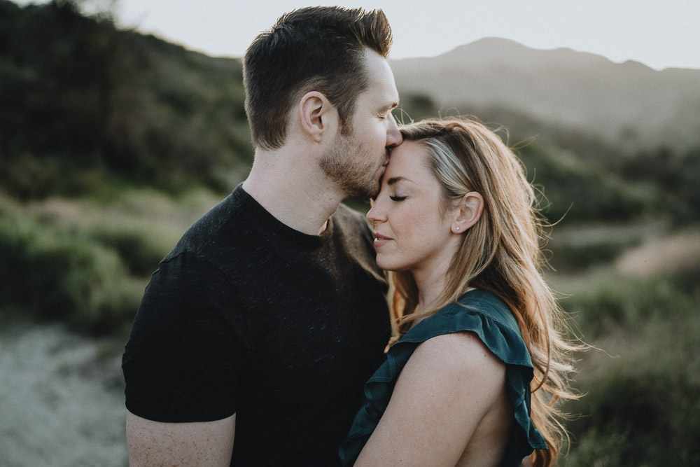 Man kisses fiancée's forehead during engagement session in los angeles canyon