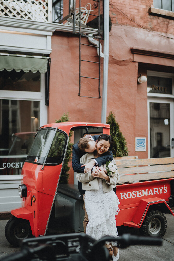 Bride and groom snuggling next to mini truck during nyc elopement