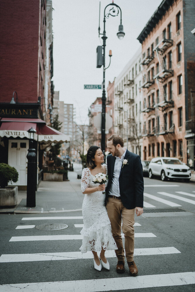 Bride and groom cross the street in the west village during nyc elopement
