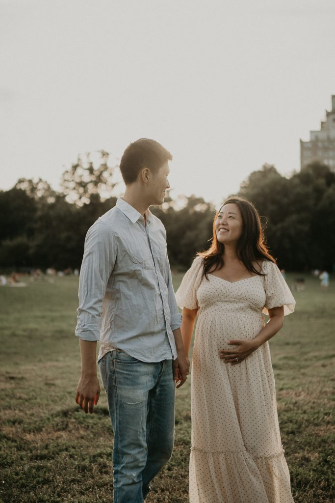 Expecting couple in prospect park at golden hour during maternity session