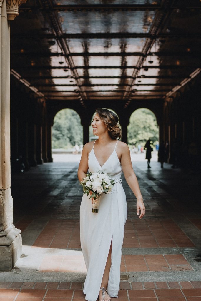 Bride at bethesda terrace during central park elopement in nyc