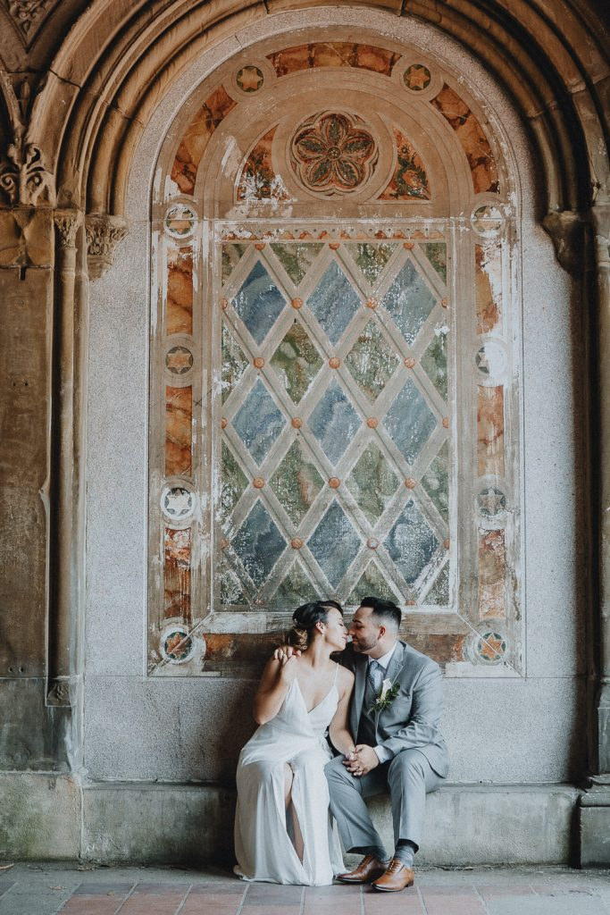 Bride and groom at bethesda terrace during central park wedding in nyc