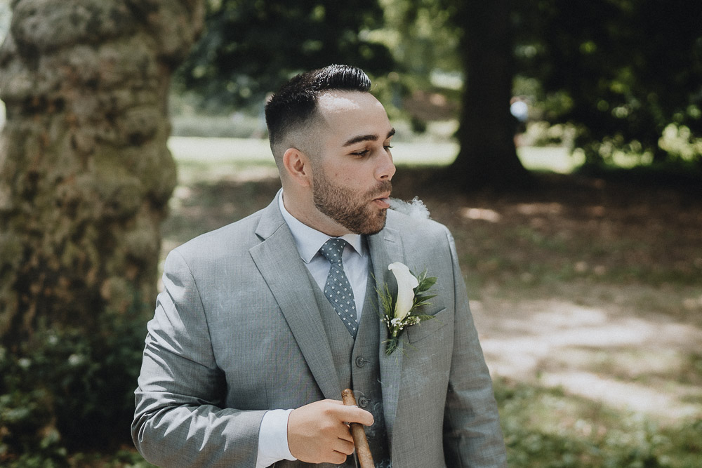 Groom smokes cigar during central park elopement in nyc