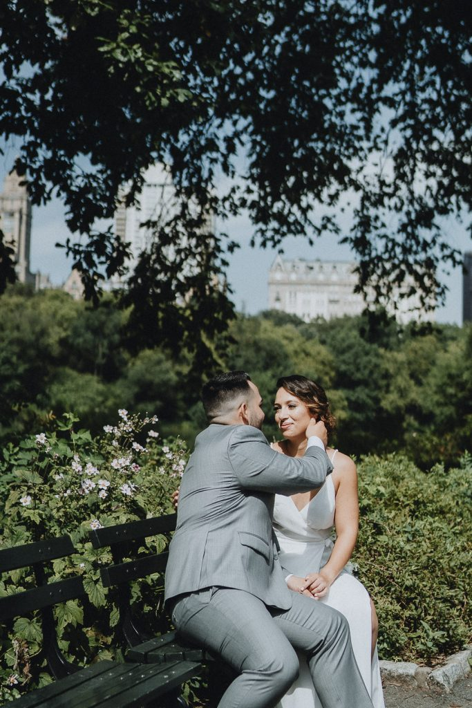 Bride and groom candid moment during central park elopement in nyc
