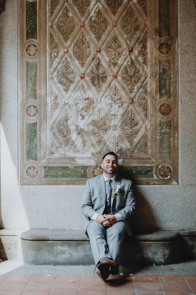 Groom at bethesda terrace during central park elopement in nyc