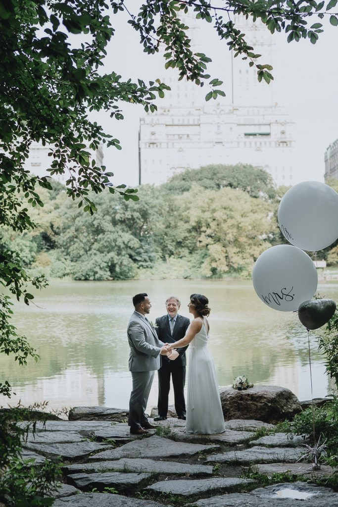 Bride and groom exchange vows during central park elopement in nyc