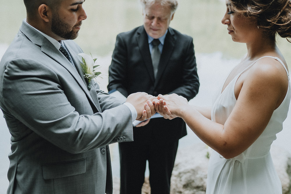 Bride and groom exchange rings during central park elopement in nyc