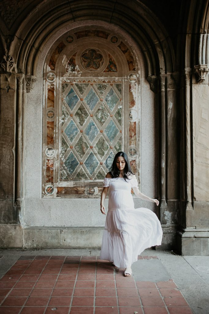 Pregnant woman in central park at bethesda terrace during maternity photoshoot