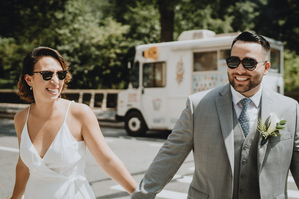 Bride and groom in nyc by ice cream truck on wedding day