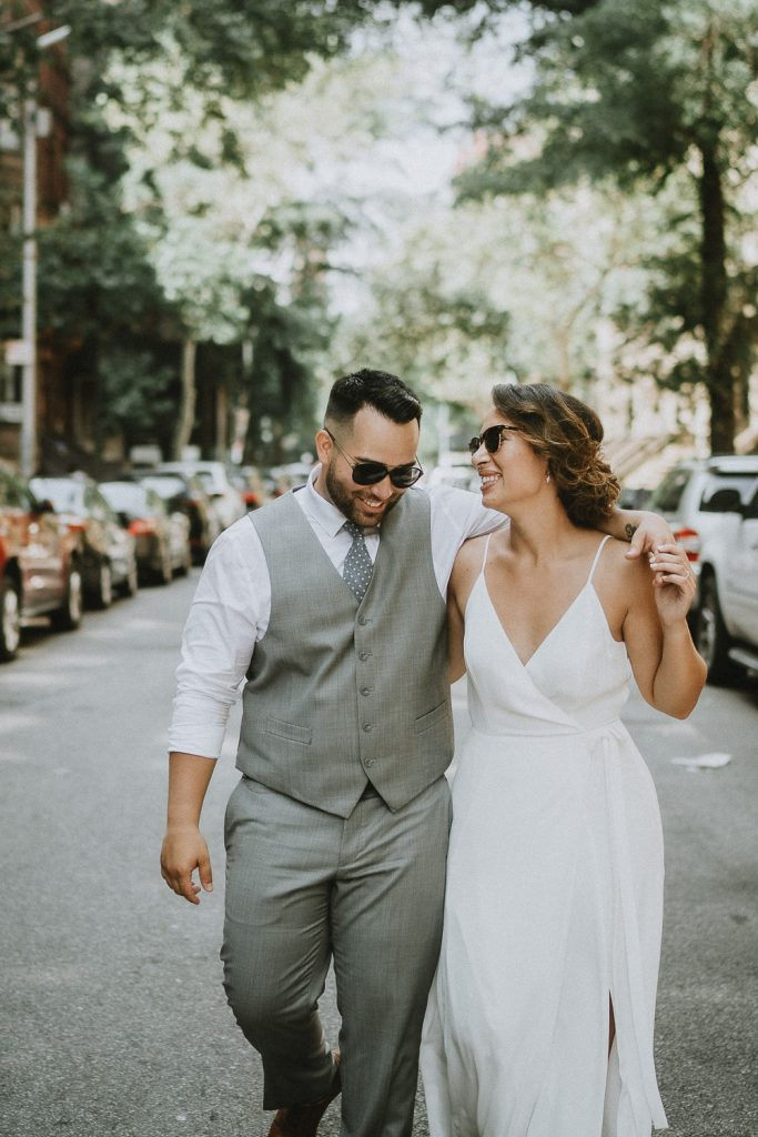 Bride and groom walking in nyc street on wedding day