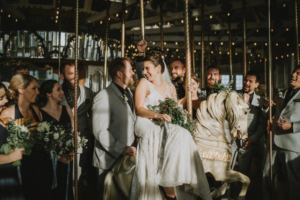 Bridal party on carousel at hudson valley wedding