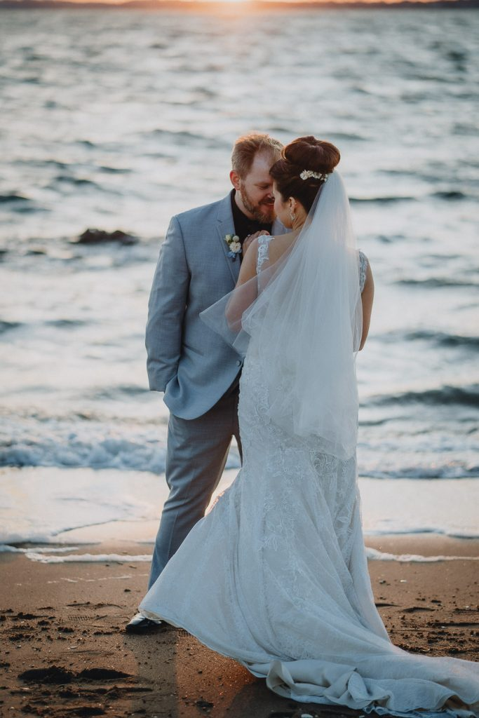 Bride and groom at beach wedding in long island at sunset
