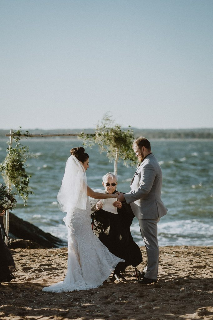 Bride and groom exchange vows during long island beach wedding ceremony