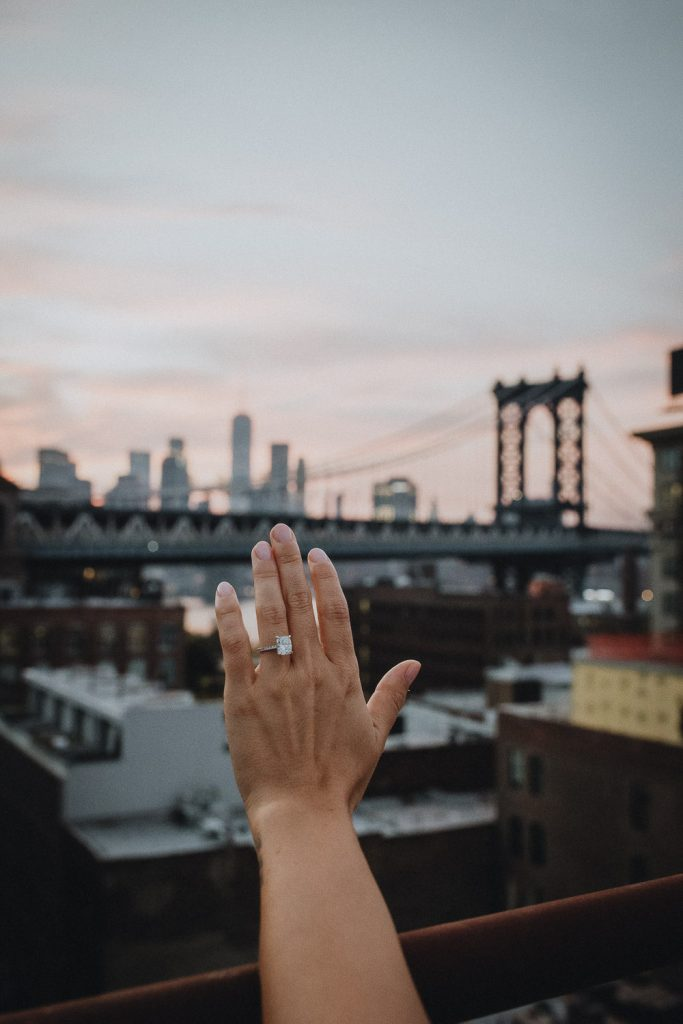 Close up of ring during dumbo rooftop engagement session