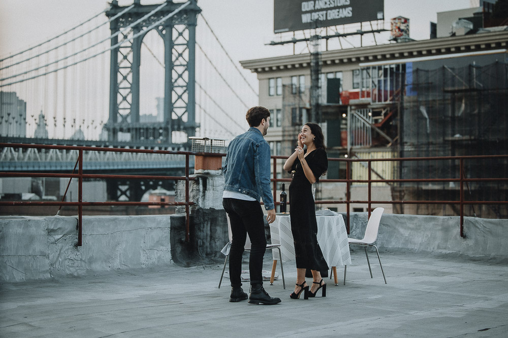 Couple on dumbo rooftop during brooklyn proposal
