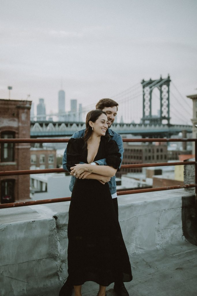 Couple on dumbo rooftop during brooklyn engagement session