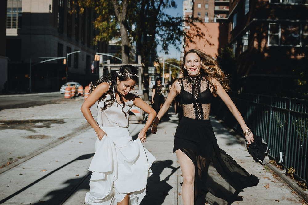 Badass bride and bridesmaid in streets of nyc before fall wedding