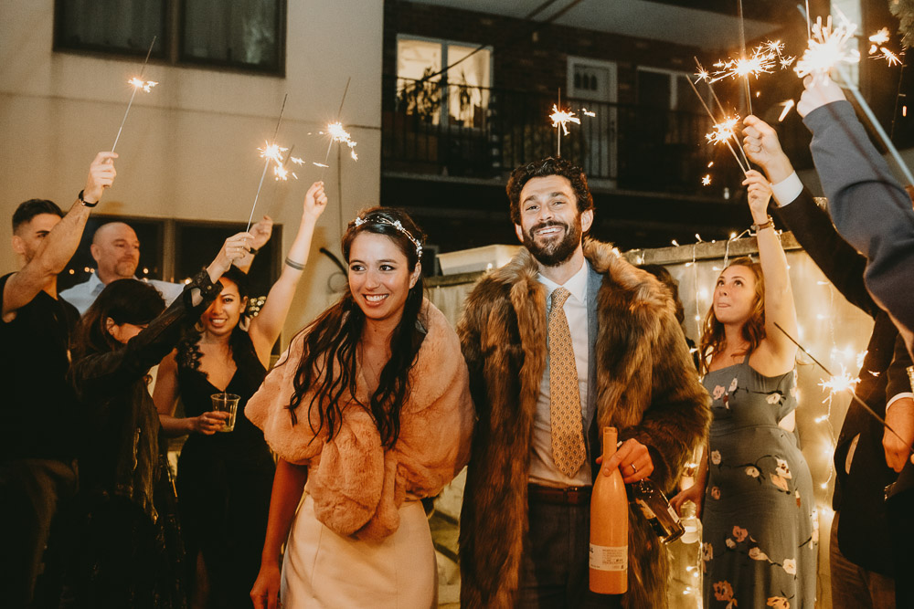 Bride and groom's sparklers exit at brooklyn backyard wedding