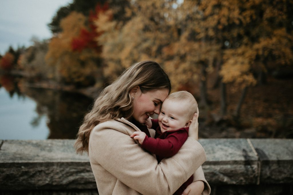 Mother and baby during fall family session in west point