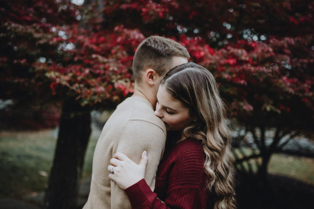 Couple during fall engagement photoshoot in west point