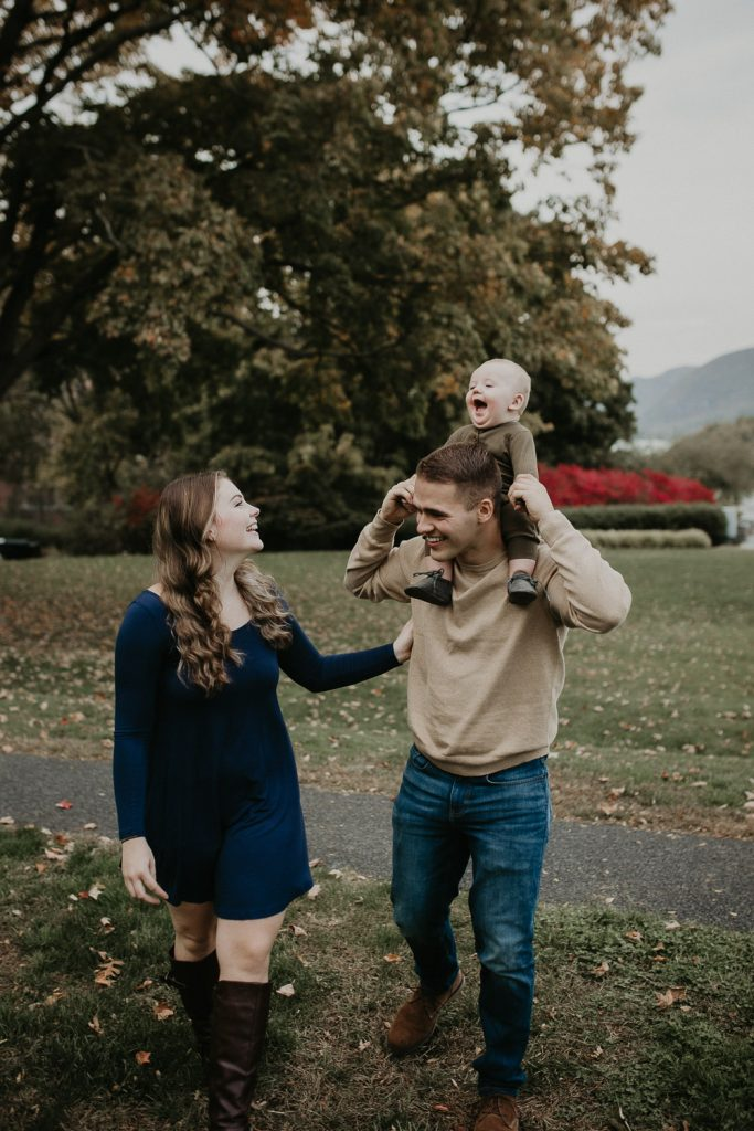 Parents and baby during fall family session in west point