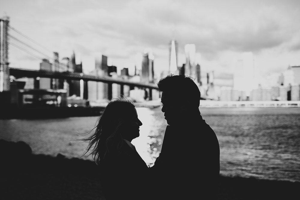 Silhouette of couple during engagement photoshoot in dumbo brooklyn