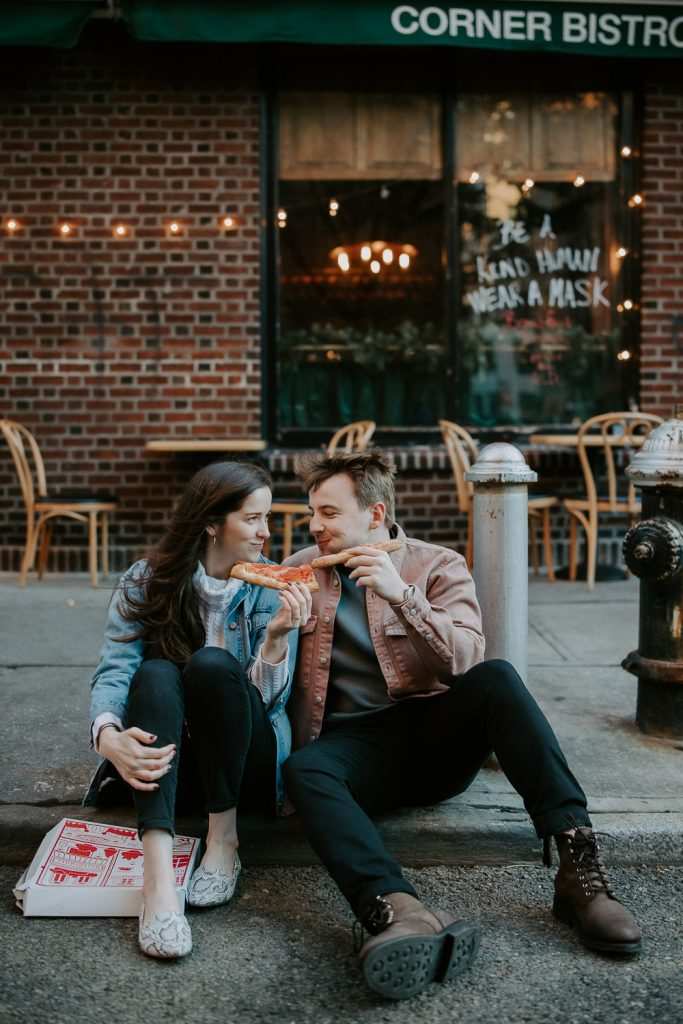 Couple eats pizza during engagement shoot in the west village of nyc