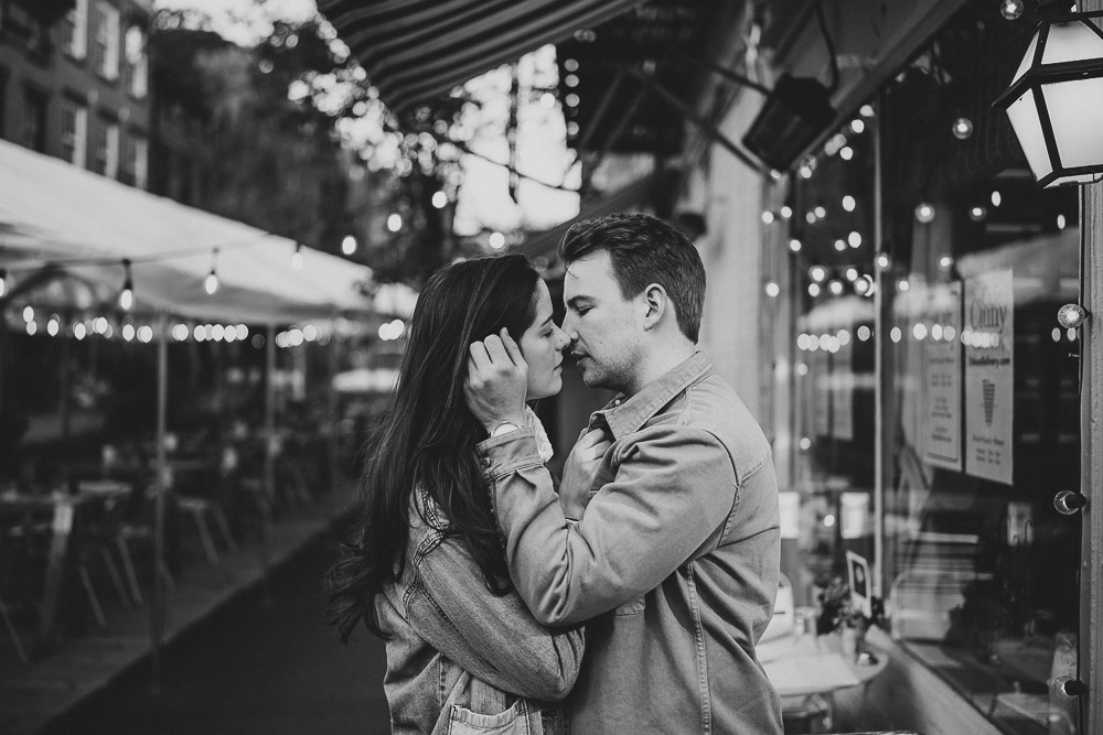 Couple kiss during engagement shoot in the west village of nyc