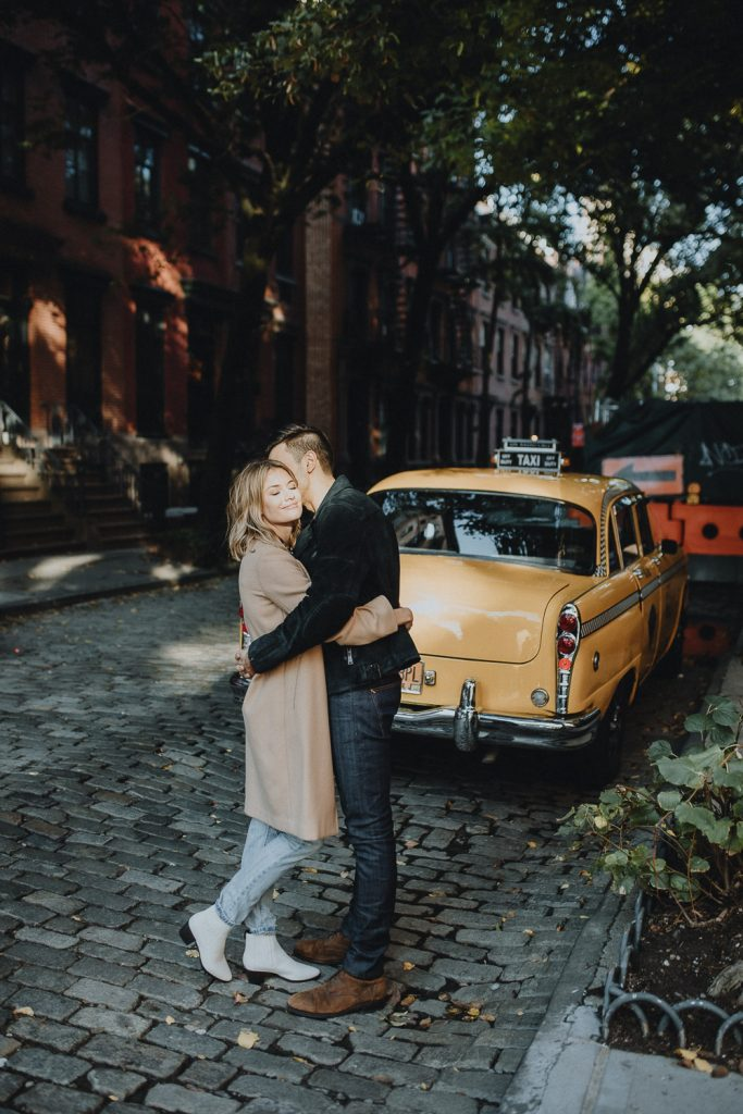 Couple by old taxi cab during nyc engagement photoshoot