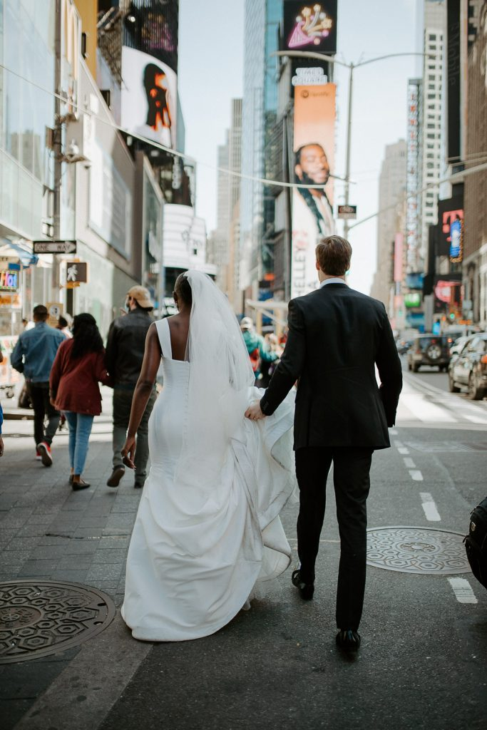 Interracial bride and groom at nyc wedding in time square