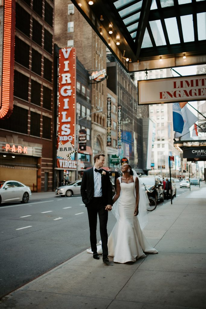 Interracial bride and groom at nyc wedding in theatre district