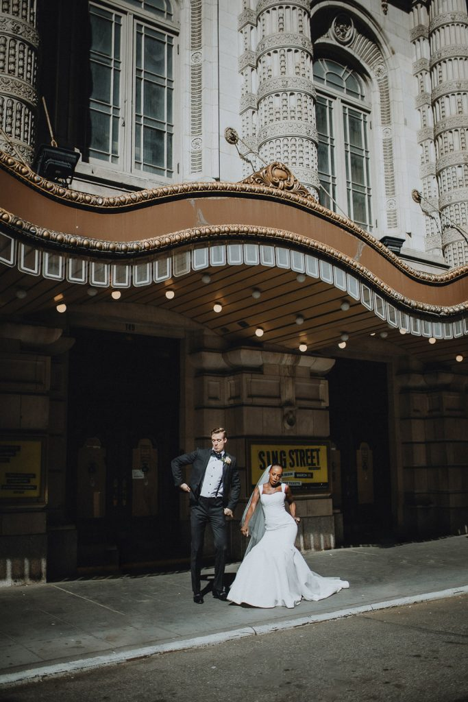 Interracial bride and groom being goofy on wedding day in nyc