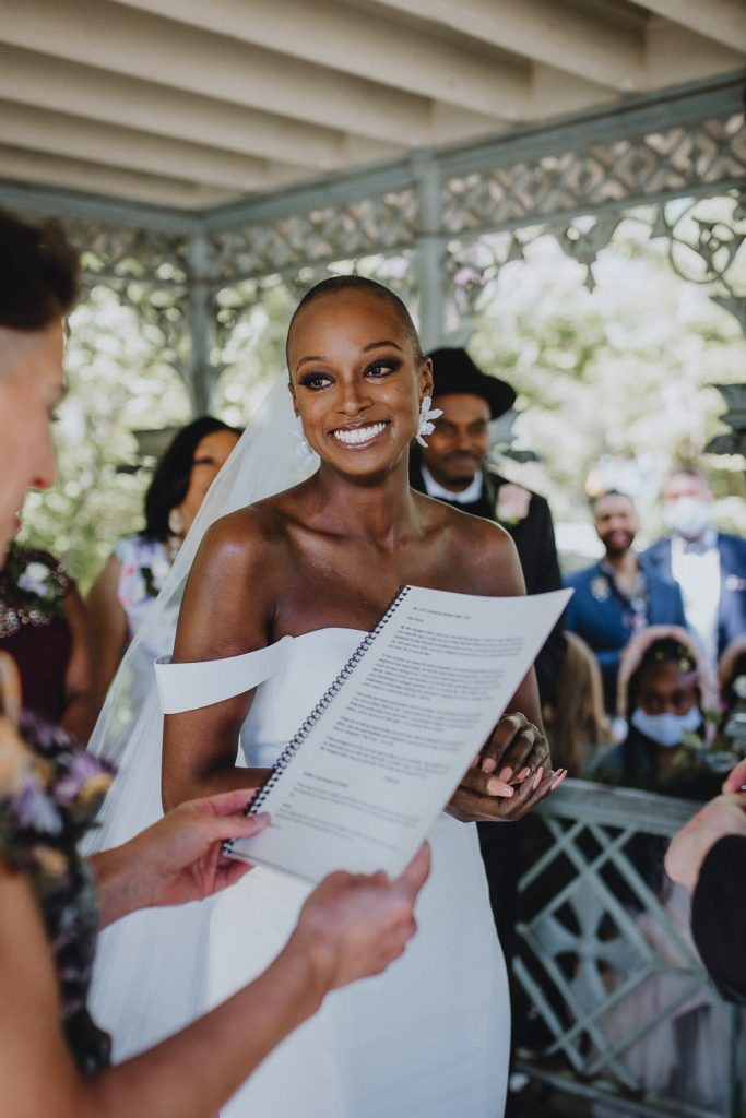 Bride cries during wedding ceremony in central park