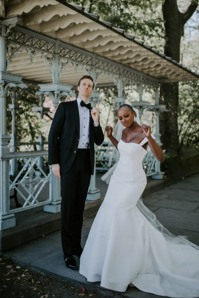 Bride and groom being silly at central park wedding in nyc
