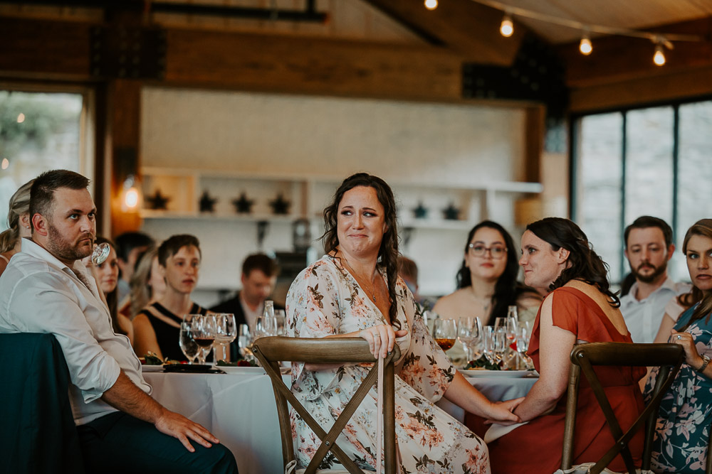 Maid of honor cries at red maple vineyard wedding reception