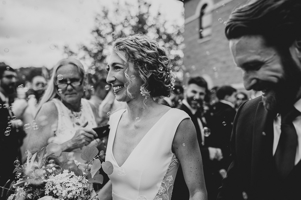 Bride and groom bubble exit after hudson valley wedding ceremony