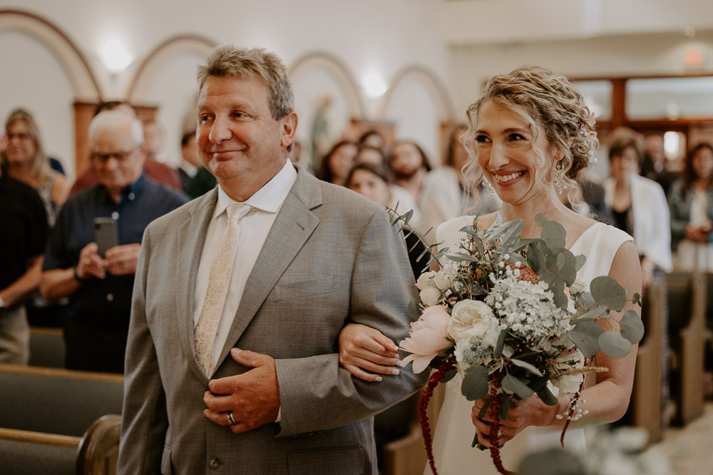 Bride walks down the aisle at hudson valley wedding ceremony