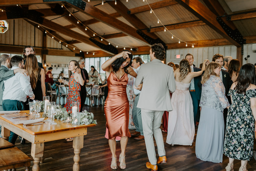 Guests dancing at red maple vineyard wedding reception