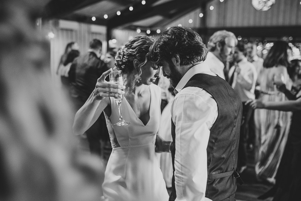 Bride and groom dancing at red maple vineyard wedding reception