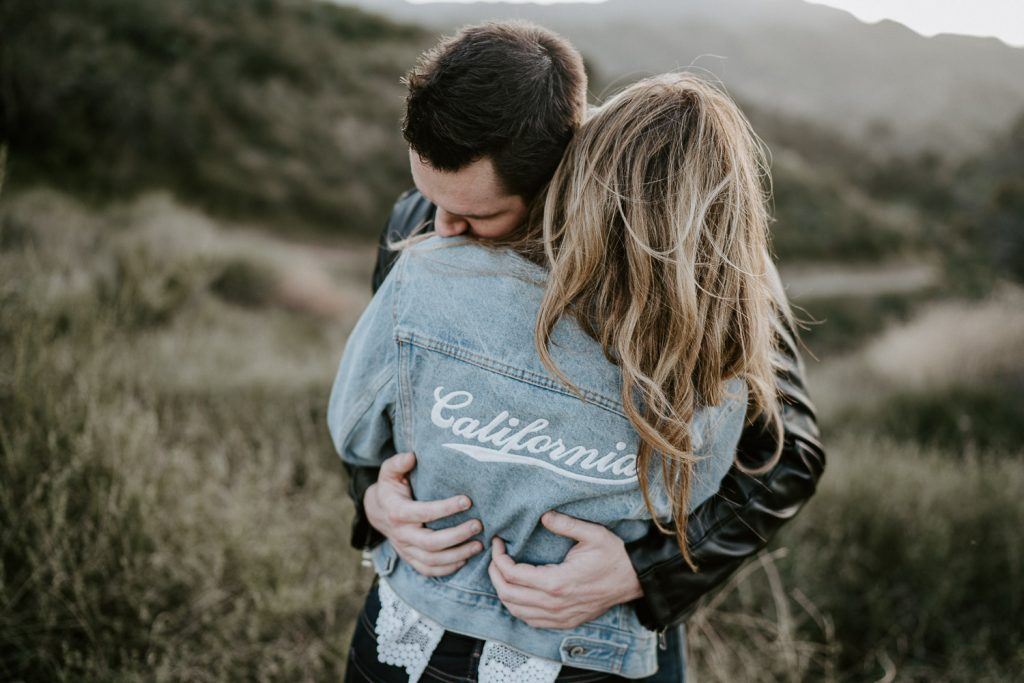 Couple during engagement session in los angeles canyon at golden hour